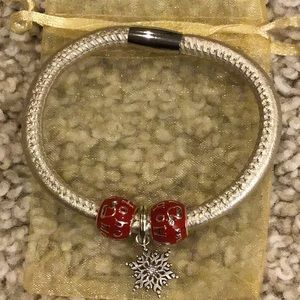 Gold Brighton bracelet with interchangeable beads.